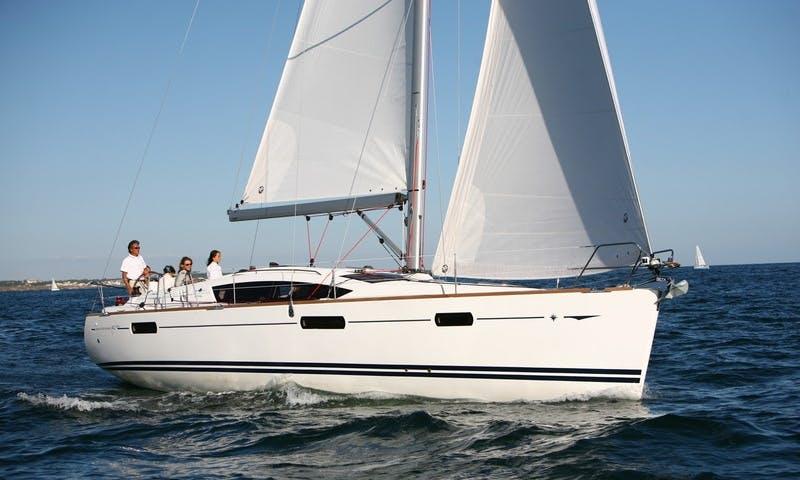 Sun Odyssey 42i Bareboat Charter in Portisco