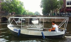Explore the Canals of Amsterdam, Netherlands on this Aluminum Boaty