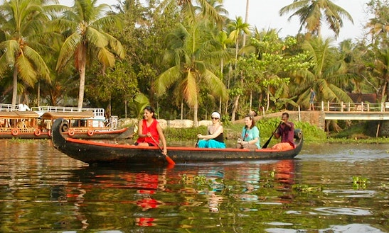 Explore Narrow Canals In Alappuzha, India On This Canoe