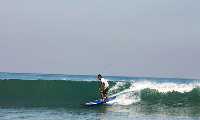 Experience the thrill of catching your first wave in Bali, Indonesia!