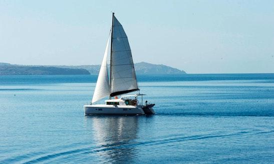 'sunset Oia' Lagoon 500 Catamaran Day Tours In Santorini