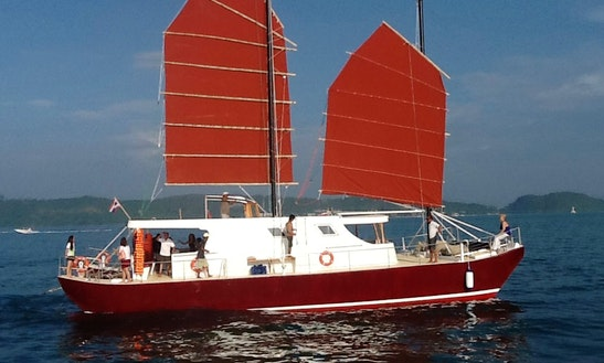 "Charter Our Catamaran Golden Dragon For A Day Sail  Enjoy A Day Trip Aboard The ""golden Dragon"", Our Spacious Catamaran: Spend A Day Far From Busy Phuket To One Of Those Islands Where You Can Find Only White Sandy Beaches, Clear Crystal Waters, Wonderful Marine Life..."