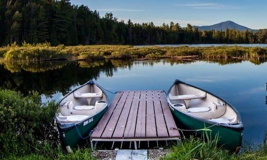 Canoeing At The Lake Placid Bay Inn On Lake Placid, New York