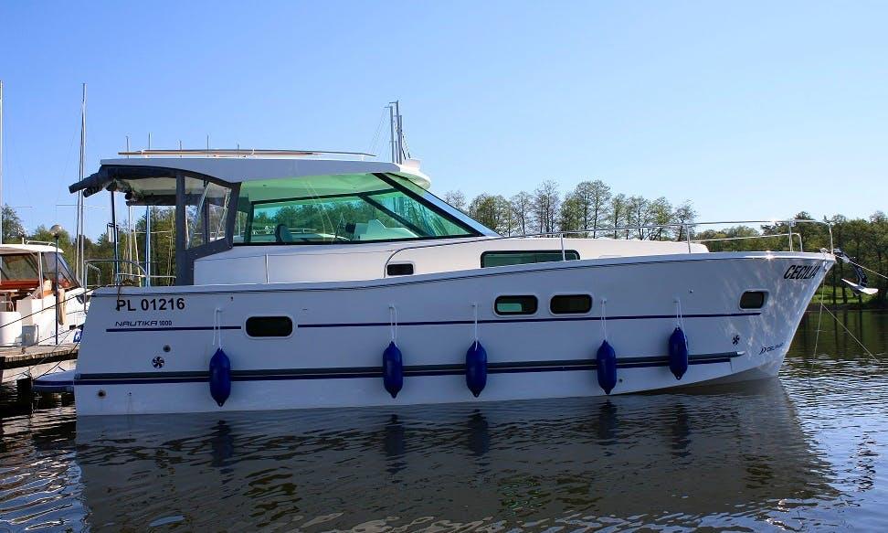 """Nautika 1000"" Motor Yacht Charter in Giżycko"