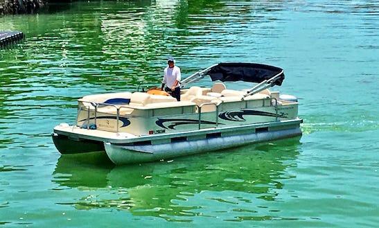 Rent The 23' Bennington Pontoon In North Bay Village, Florida