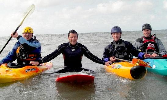 Enjoy Surf Kayaking In Porthcawl, Wales