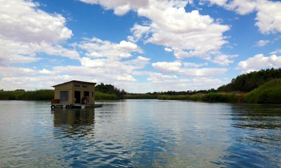 Sleep aboard this Houseboat on the majestic Orange River for R1500 per night, in Upington.