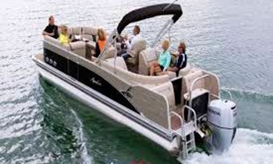 Rent The 24ft Avalon Black Pontoon Boat From Helena Township, Michigan