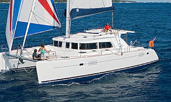 Charter 44' Lagoon Cruising Catamaran In Portiglioni, Italy