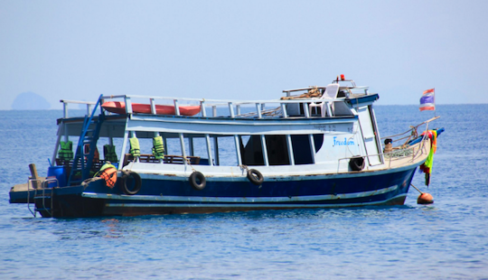 Hit The Water Of Tambon Ko Lanta Noi, Thailand On A 15 Person Trawler