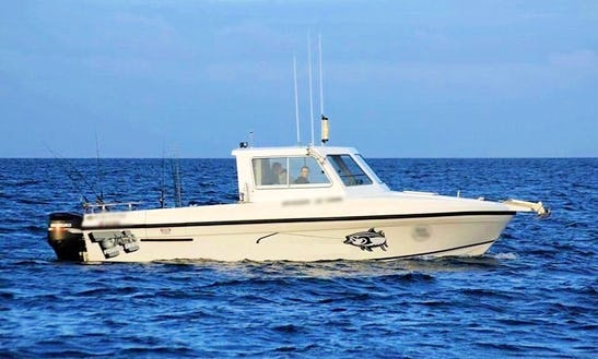 Fishing Aboard The 18' Cuddy Cabin In Lakes Entrance, Victoria With Captain Tony