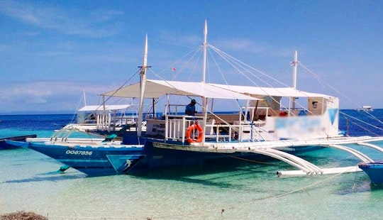 'devocean' Outrigger Boat Diving Trips In Bounty Beach