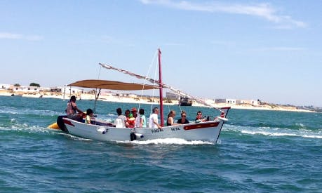 Charter a traditional wooden fishing boat with Captain, in Olhao. Portugal
