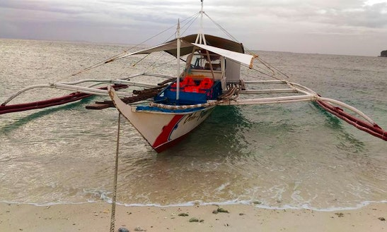 Explore By A Traditional Boat Charter In Carles, Philippines