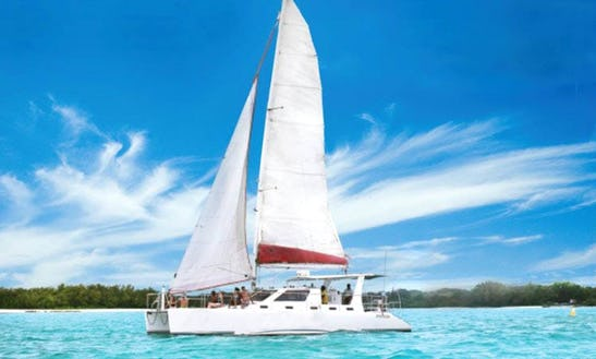 Relax And Set Sail For The Day In Trou D'eau Douce, Mauritius On A Cruising Catamaran