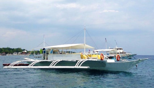 Charter A Traditional Boat Close To Hilton Port In Philippines