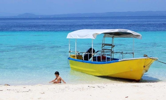 Divers Diving Boat In Philippines