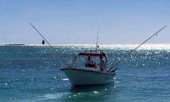 Enjoy Fishing In La Gaulette, Mauritius On Center Console