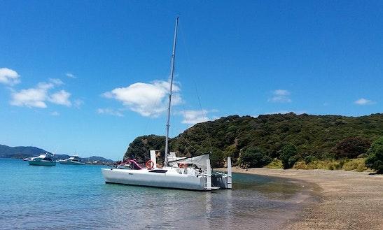 Charter 33ft Tennant Turissimo Cruising Catamaran In Paihia, New Zealand. Paihia Beach