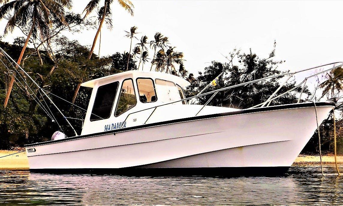 Enjoy Fishing in Taveunii, Fiji on 32' Cuddy Cabin with  Captain John