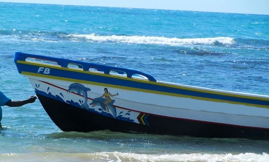 Experience The Sea Of Treasure Beach, Jamaica With This Dignhy Rental