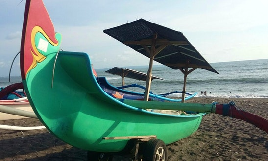 Enjoy Mengwi, Bali On This Green Colour Traditional Boat
