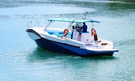 Enjoy Fishing In  Victoria, Seychelles On Center Console