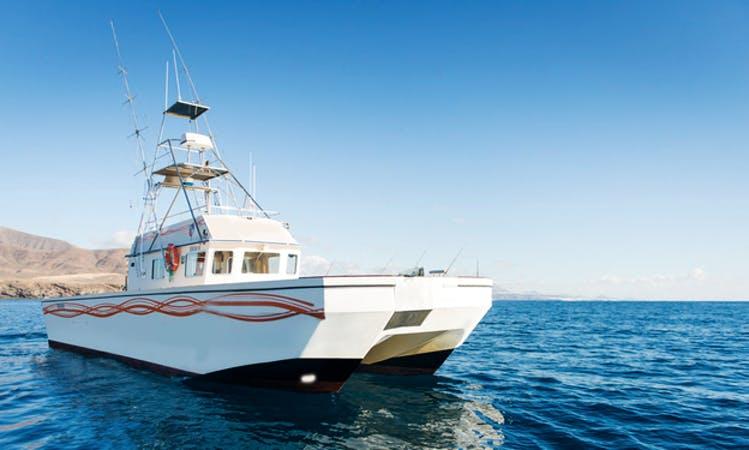 Fishing in Puerto Calero, Canary Islands on 54' Power Catamaran