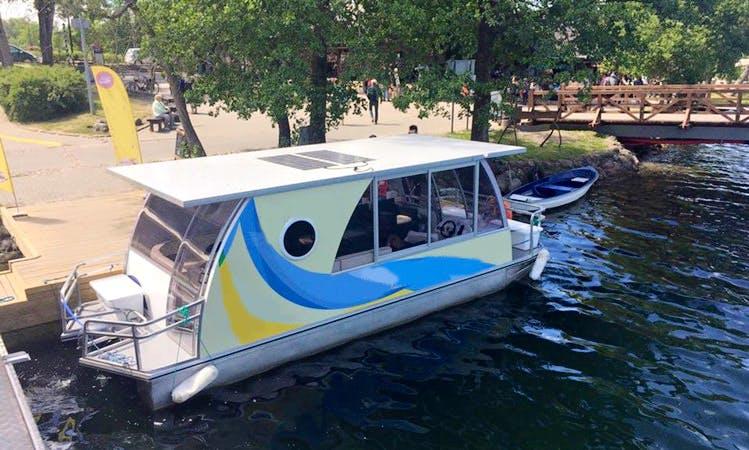 Charter a Close Pontoon Boat in Trakai, Vilniaus apskritis for 13 Pax