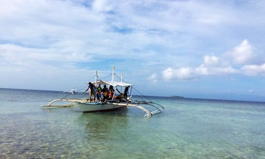 Tour By Traditional Boat With Local Guide In Oslob, Philippines