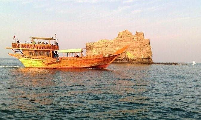 Go on a boat trip on a traditional Dhow boat in Muscat, Oman