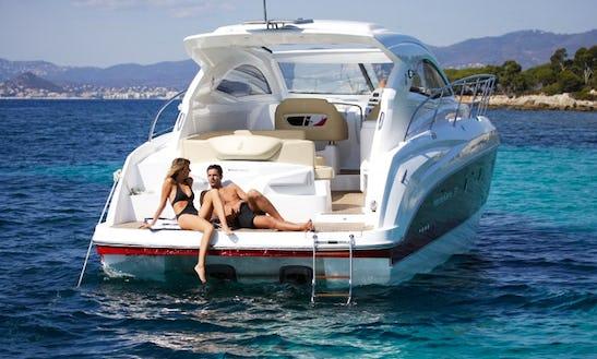 Rent The 2008 Beneteau Monte Carlo 37 Motor Yacht In Barcelona, Spain