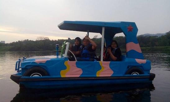 Cruise In Style On Aa Electric Boat Rental In Melaka, Malaysia