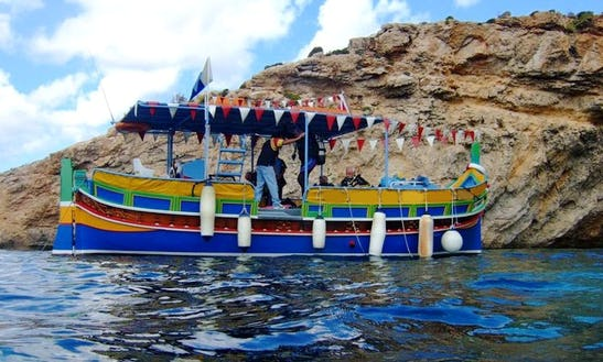 Charter A Luzzu Traditional Boat In Buġibba, Malta