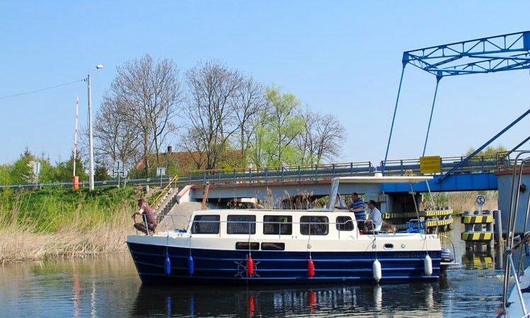 Choose the Vistula Cruiser 30 Houseboat in Rybina, Poland