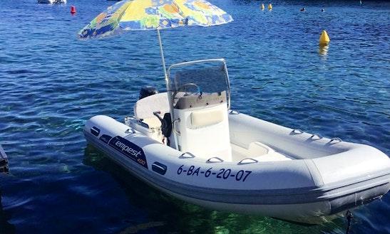 Rent 13' Tempest Hair 400 Rigid Inflatable Boat In Cadaqués, Spain