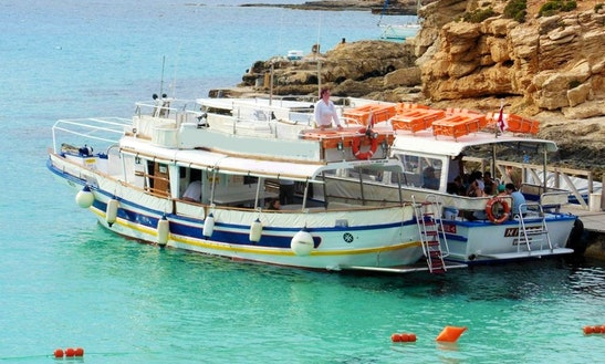 Private Charter And Tour Aboard A 47' Motor Yacht In Xlendi Bay, Munxar