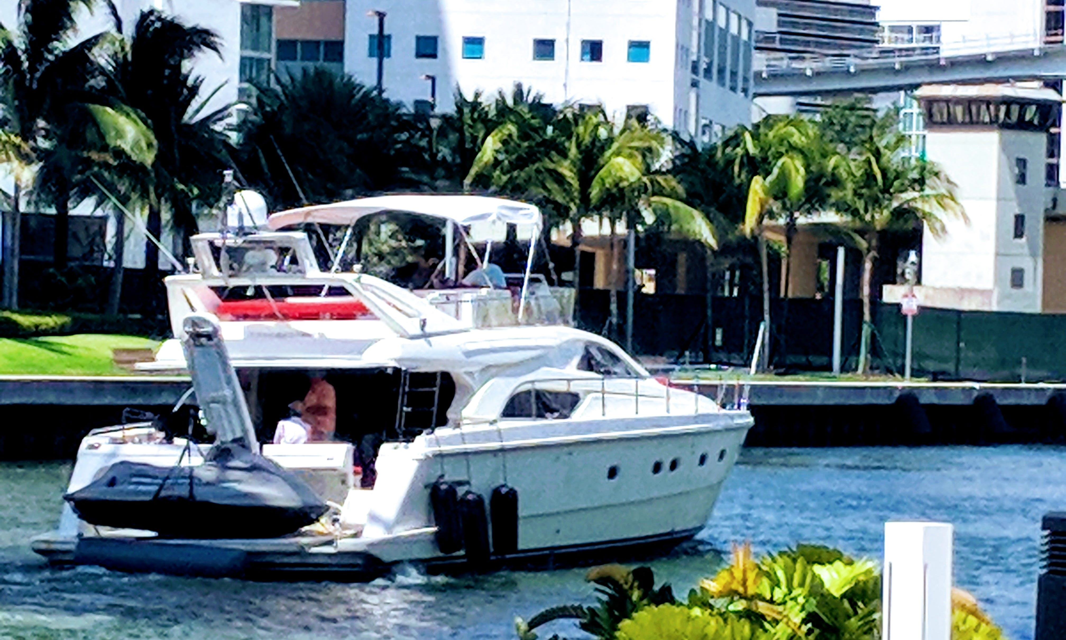 Take 13 of you closest out with this luxury 60 ft. yacht with a flybridge in Miami Beach