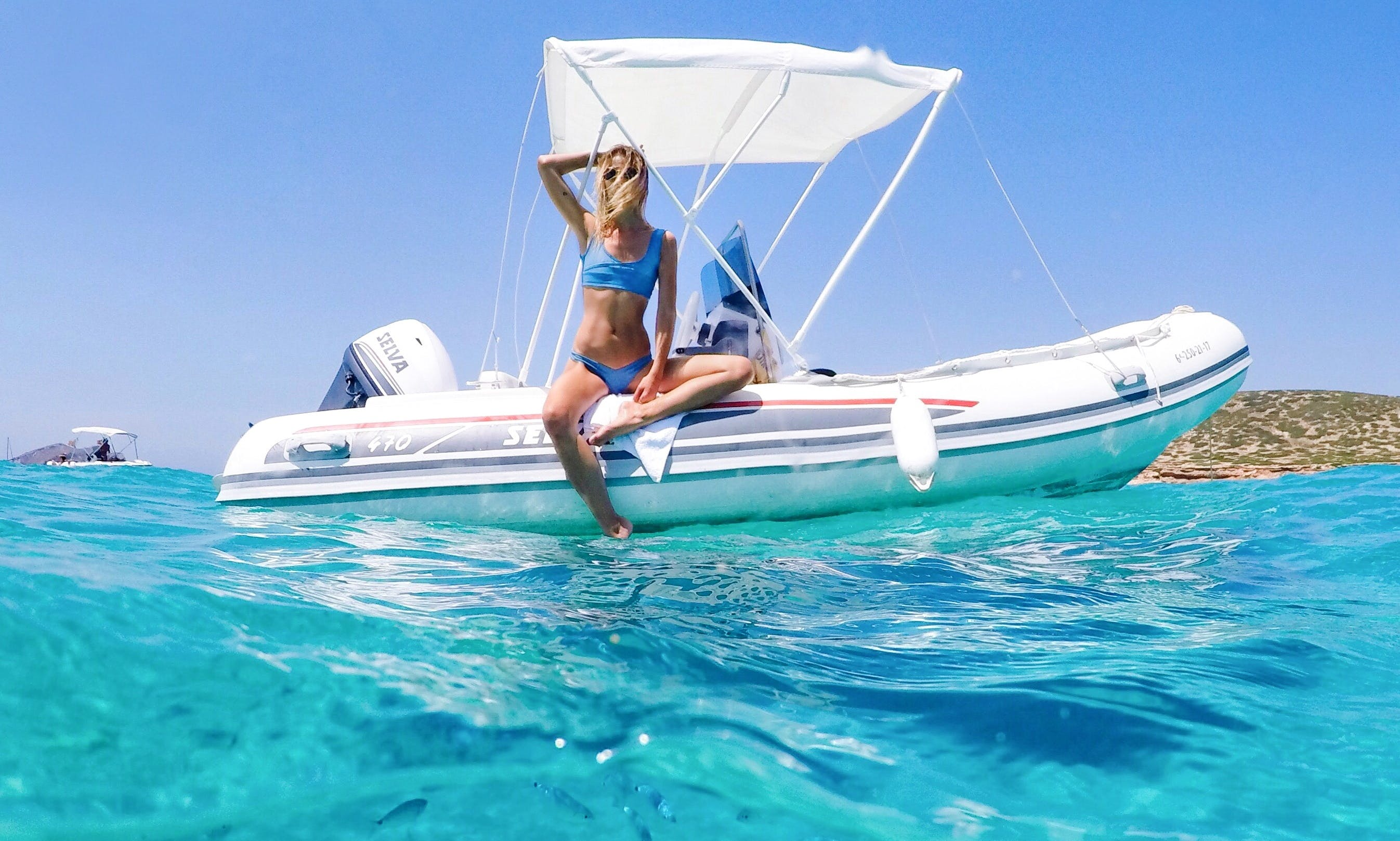 Enjoy an island hopping experience with this RIB rental in Sant Antoni de Portmany, Spain