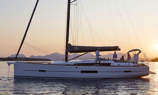 Charter Dufour 520 Gran Large - Cala Di Volpe Cruising Monohull In Portisco, Italy