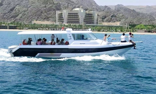 Enjoy Dolphin Watching Tours And Snorkeling Trips In Muscat, Oman On Cuddy Cabin