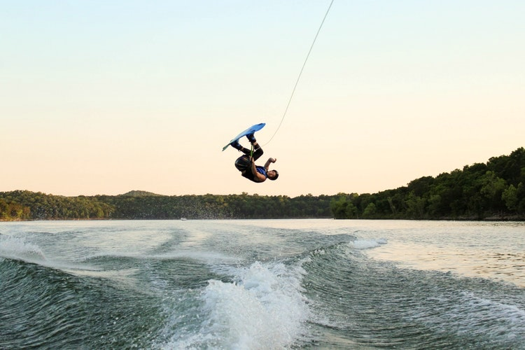 Man flipping on wakeboard on Table Rock Lake
