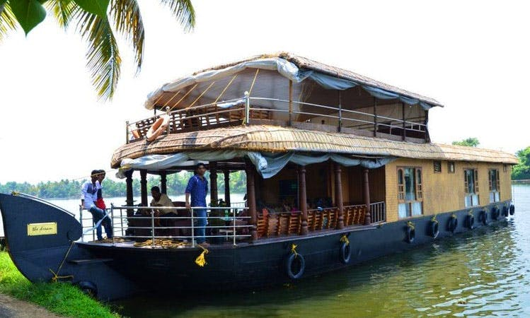 Experience this 6 Person Houseboat to Cruise the Backwater of Kerala