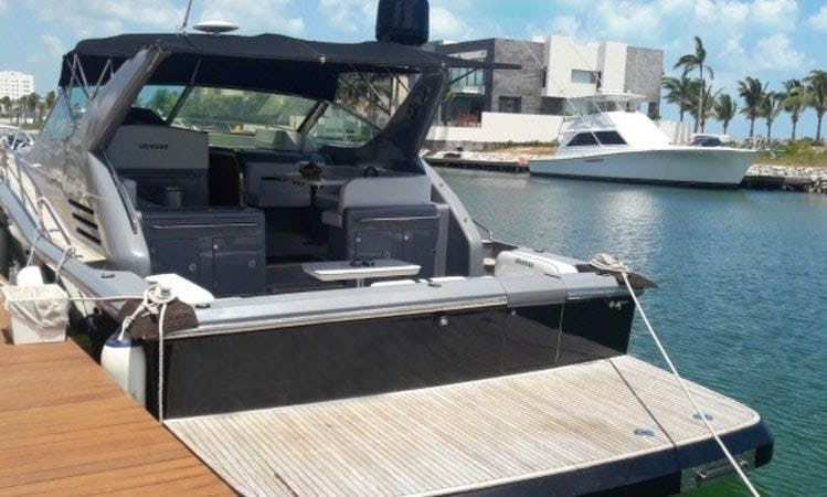 Have an amazing time in Cancún, Quintana Roo on 48' Uniesse Spartan motor yacht