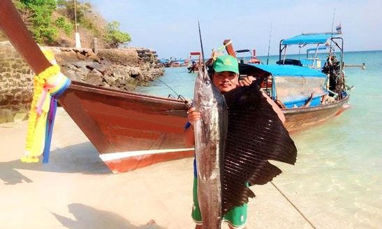 Enjoy Fishing In Krabi, Thailand On A Longtail Boat