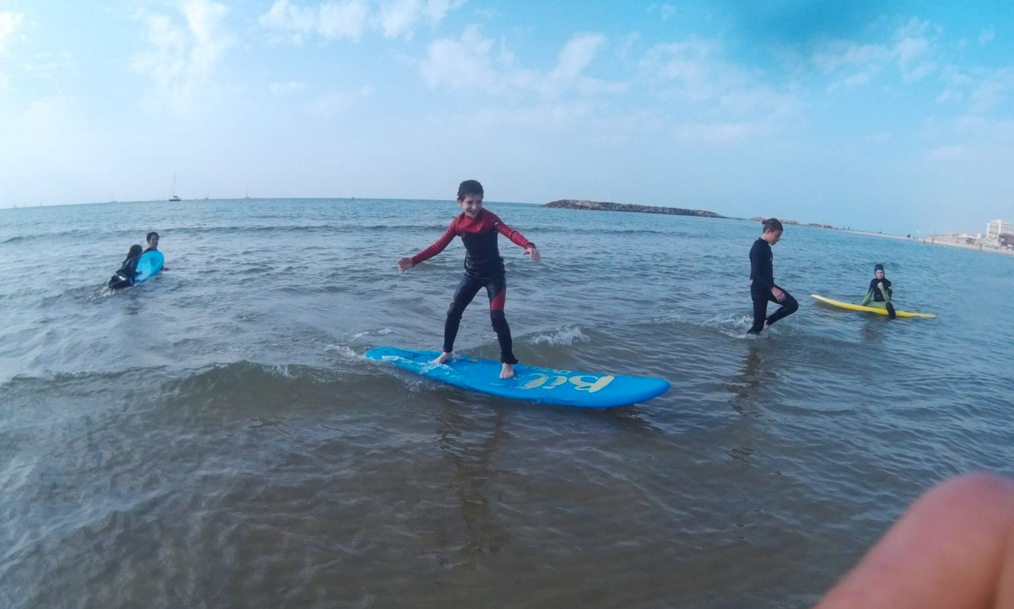 Surfing with Instructor Assaf at the Handicapped beach in Herzliya, Israel