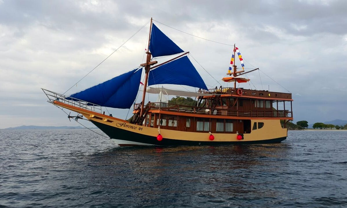 Explore Barat, Indonesia with family and friends aboard this 89' traditional phinisi boat
