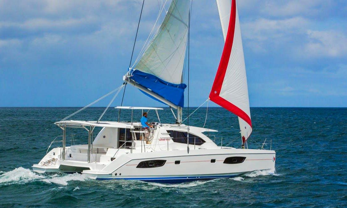 Navigate a 44' Sailing Catamaran in Belizean Coast