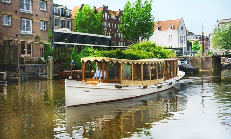 Chic and Luxurious Classic Canal Boat in Amsterdam