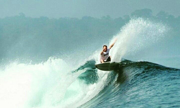 Learn Surfing with Hapiness at Carita Beach in Indonesia